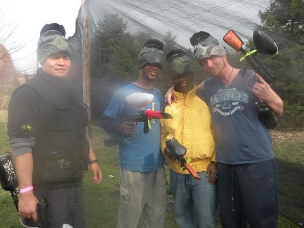 A picture of staff playing paintball