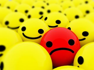 Unhappy_red_smiley_in_group_of_yellow_happy_smileys