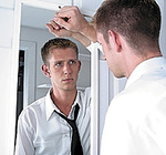 Young_man_looking_in_mirror